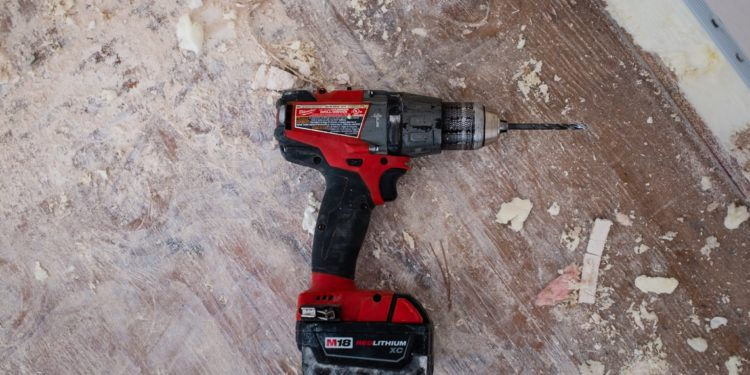 How to Use a Drill to Screw into the Wall